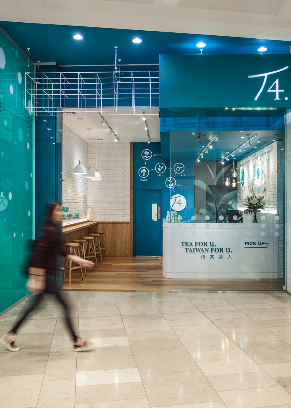 design clarity, shopfront design, tea store, soft drinks, metal canopy, turquoise paint, welcoming entrance, exposed lighting