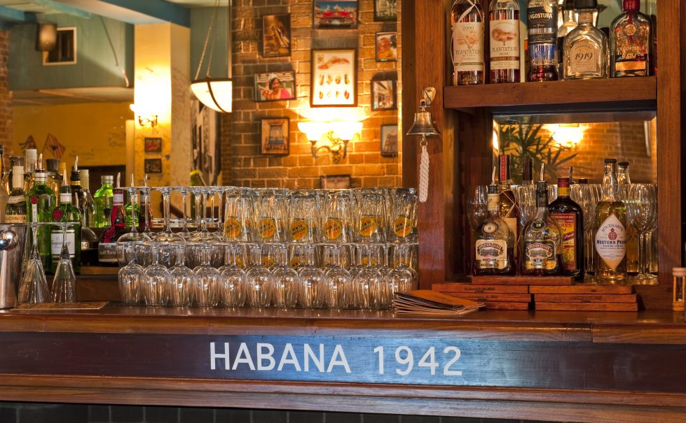 design clarity, cuban bar, bodeguita, habana, wooden bar, traditional back bar, brick wall, warm atmosphere