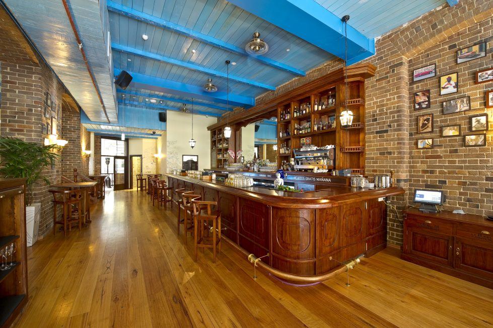 design clarity, bar design, wooden bar, brass foot rail, timber and brick, spanish style, cuban bar, character, amazing interior