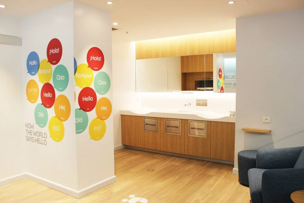design clarity, baby change room design, breastfeeding area, parent facilities, cool signage on walls, graphics, warm timber flooring