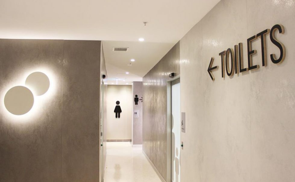 design clarity, toilet interior design, concrete walls, moroccan style plastered wall, signage design, toilet sign