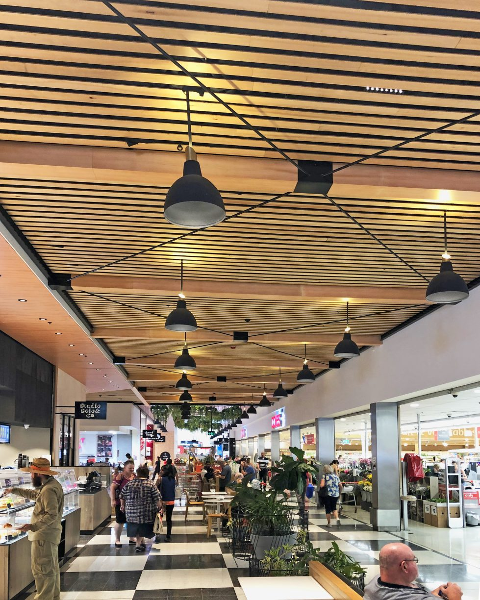 design clarity, food market, ceiling feature, timber slatting, planting, food market, checked flooring tiles, industrial design